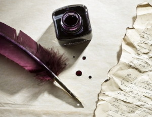 letter with ink and purple feather